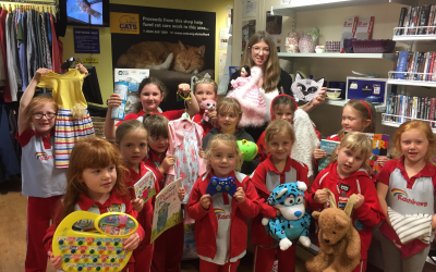 1st Walton Rainbows 'Take Action' In Local Charity Shop